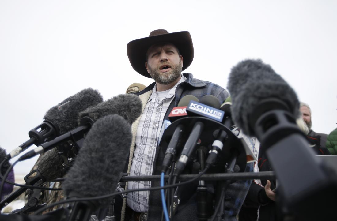 Ammon Bundy, one of the sons of Nevada rancher Cliven Bundy, speaks with reporters during a news conference at Malheur National Wildlife Refuge headquarters Monday, Jan. 4, 2016, near Burns, Ore. Bundy, who was involved in a 2014 standoff with the government over grazing rights, told reporters on Monday that two local ranchers who face long prison sentences for setting fire to land have been treated unfairly. (AP Photo/Rick Bowmer)